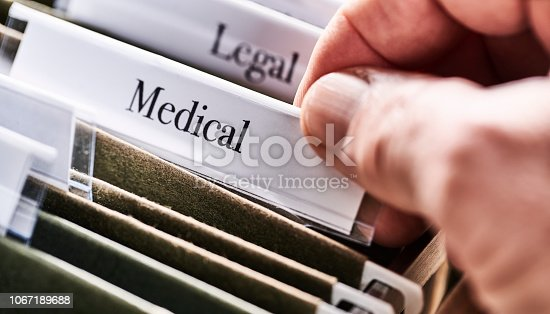 MEDICAL: Files and folders in desk drawer with labels and tabs: Home office management