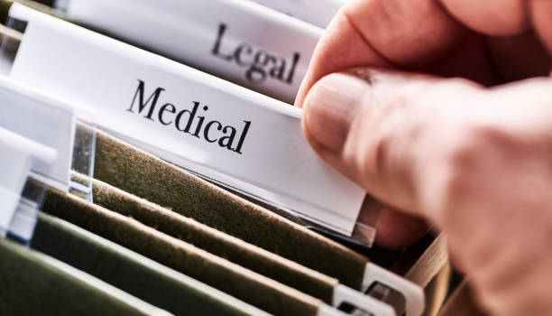 MEDICAL: Files and folders in desk drawer with labels and tabs: Home office management stock photo