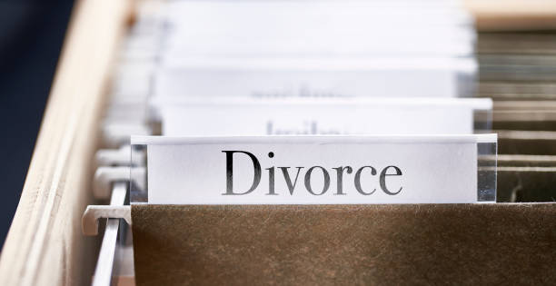 DIVORCE: Files and folders in desk drawer with labels and tabs stock photo