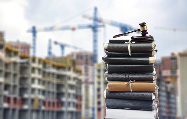Files with gavel, buildings and cranes stock photo