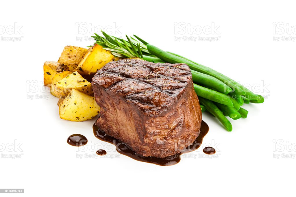 Filet mignon arranged with asparagus and gold potatoes stock photo