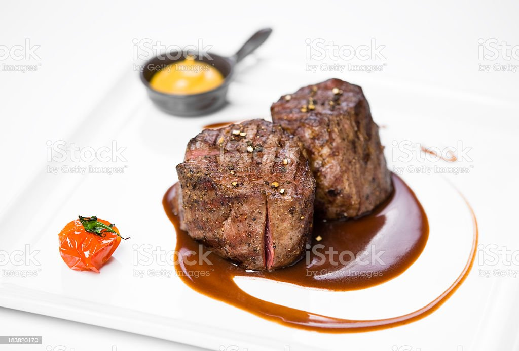 Filet Mignon dish with sauces and pepper stock photo