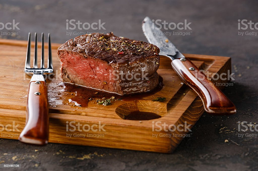 Filet Mignon Steak on wooden board stock photo