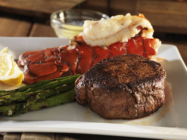 filet mignon steak with lobster tail stock photo