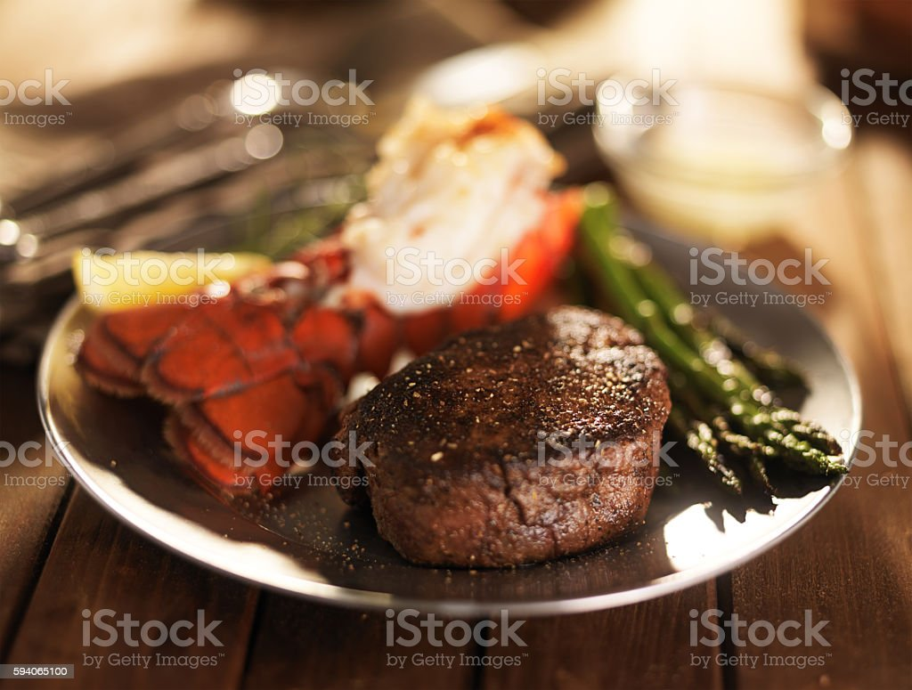 filet mignon steak with lobster tail surf and turf meal stock photo