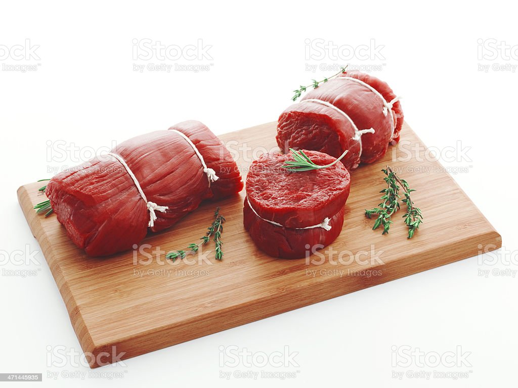filet mignon with herbs on cutting board royalty-free stock photo