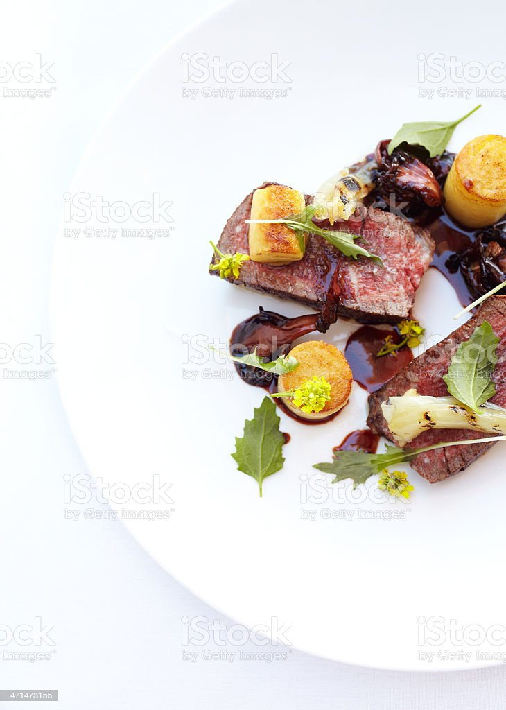 Filet mignon with potato fondant in port reduction stock photo
