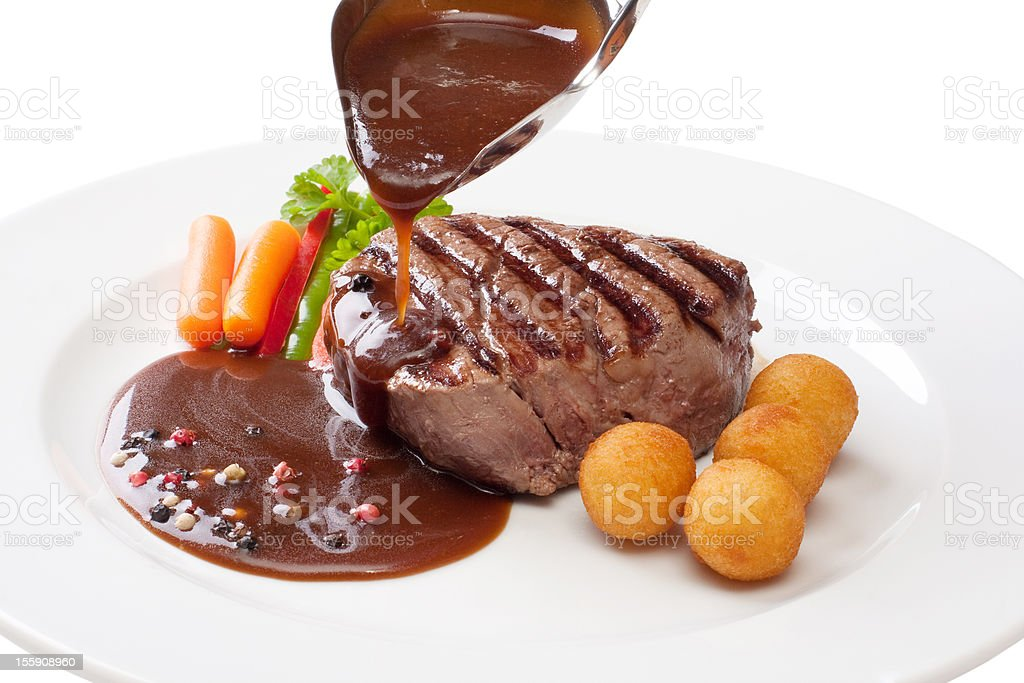 Filet mignon with sauce on a white plate stock photo