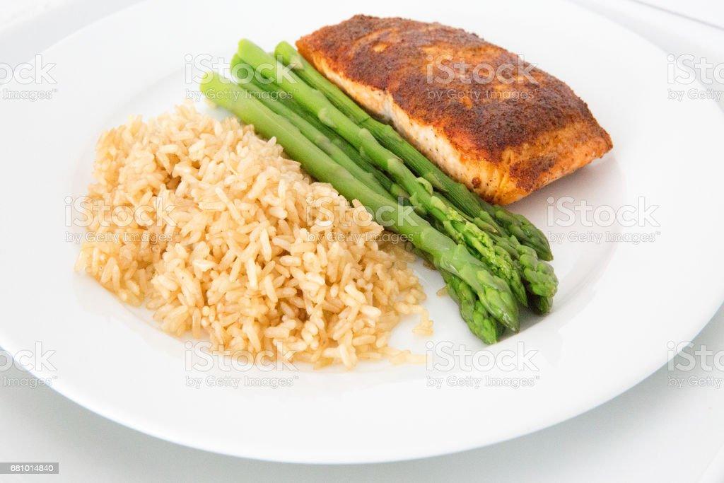 filet of salmon brown rice asparagus stock photo