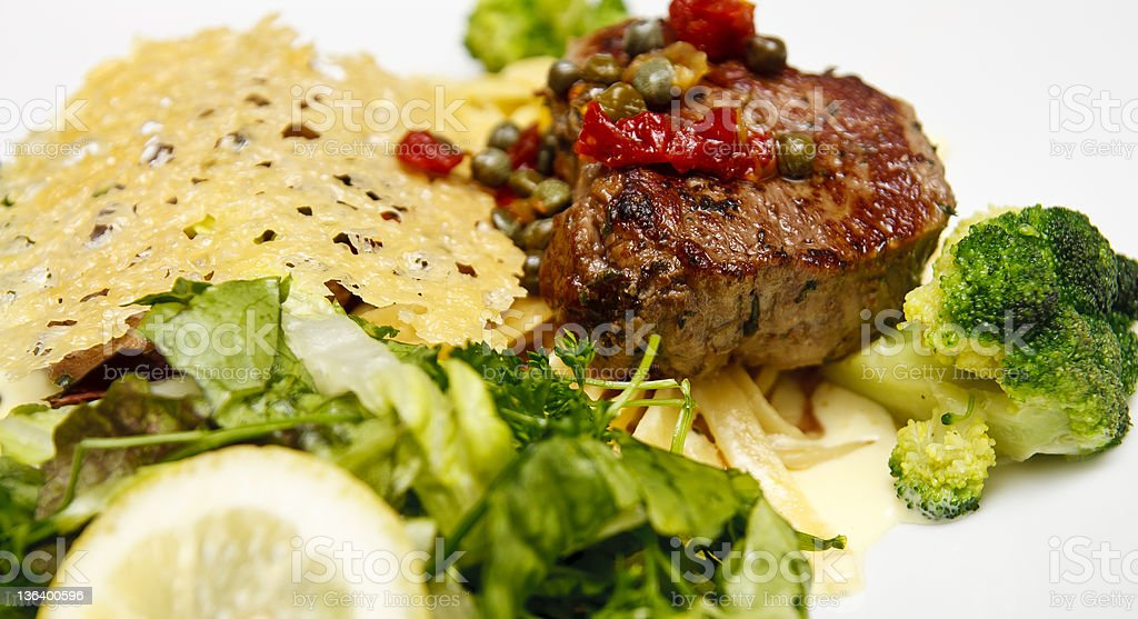 Filet with Broccoli and Waffled Potatoes royalty-free stock photo