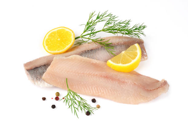 filets of herring isolated - herring stock photos and pictures