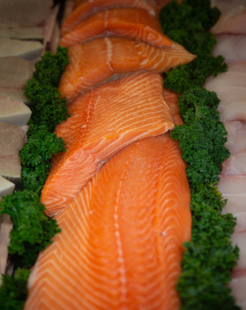 Filets of Raw Atlantic Salmon Filets of Raw Atlantic Salmon atlantic salmon stock pictures, royalty-free photos & images