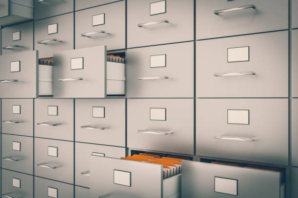 filing cabinet with yellow folders in an open drawers - file stock pictures, royalty-free photos & images
