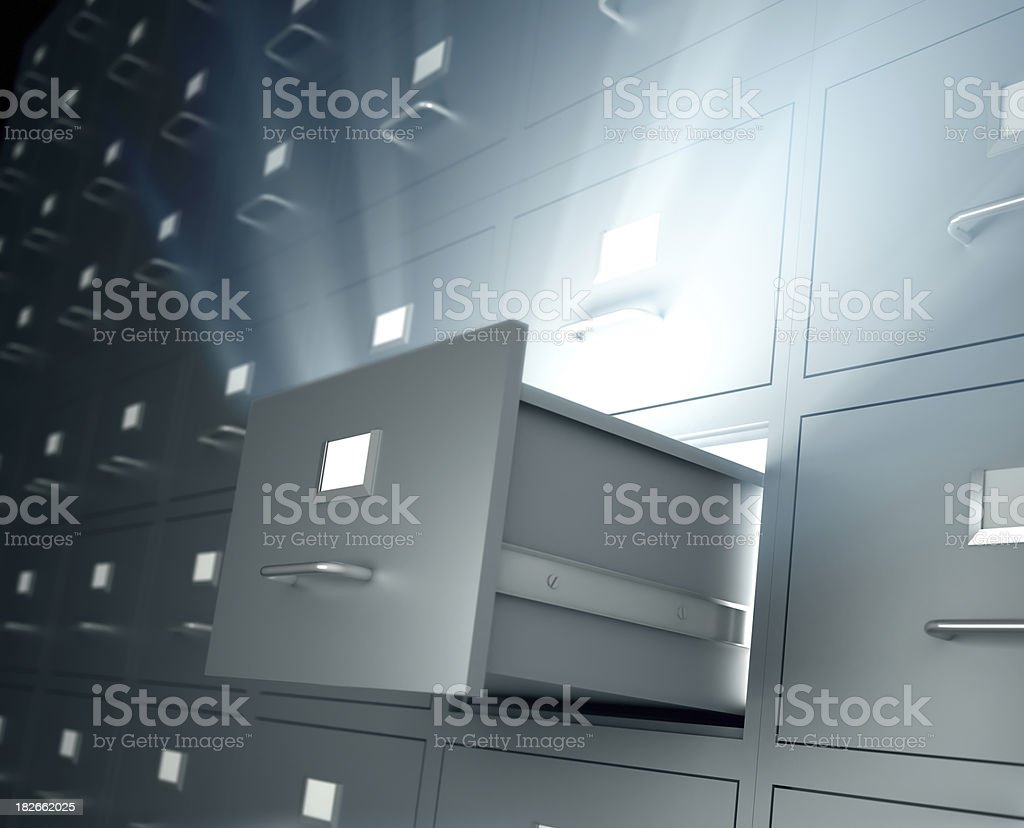 Filing cabinets, one open drawer emitting light royalty-free stock photo