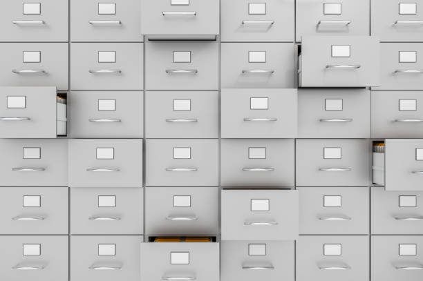 Filing cabinets with open drawers - data collection concept stock photo