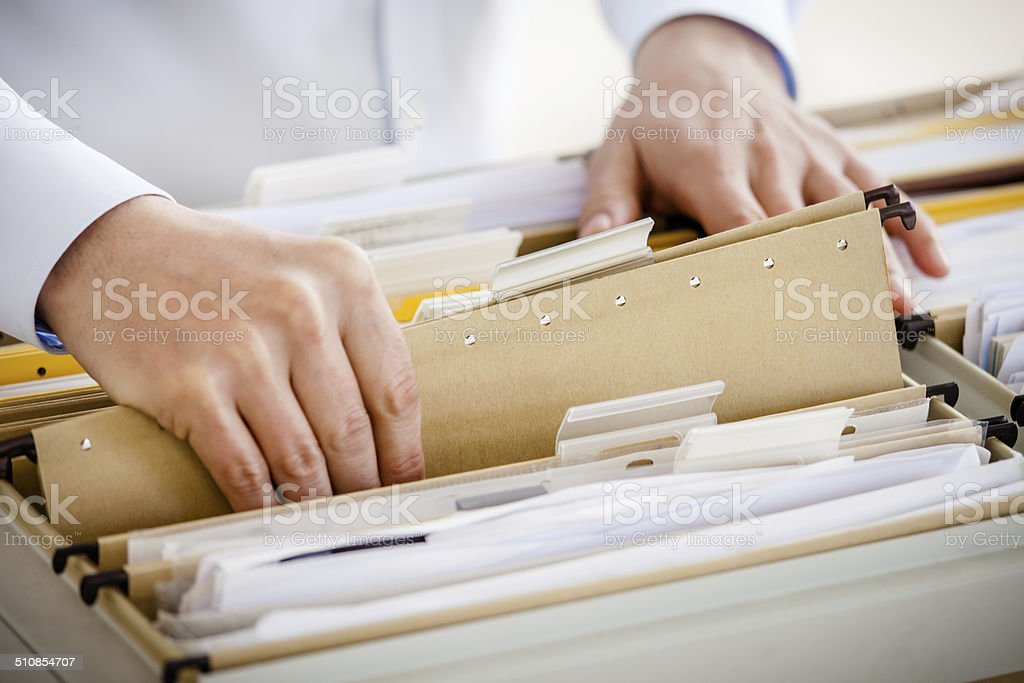 Filing In File Cabinet stock photo