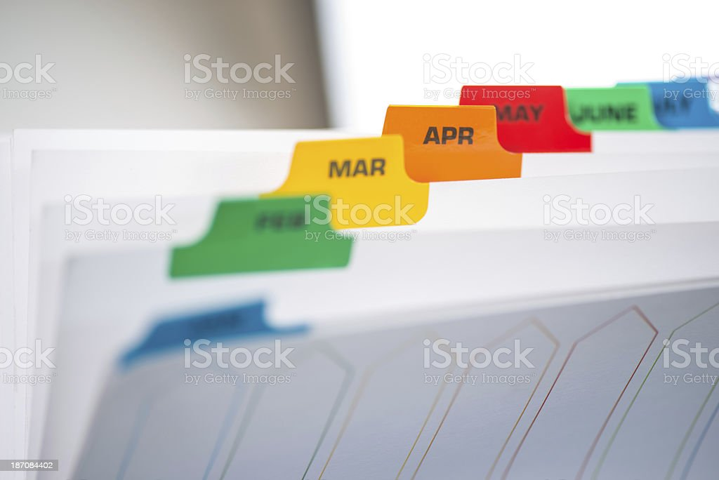 Filing Separators with coloured monthly tabs stock photo