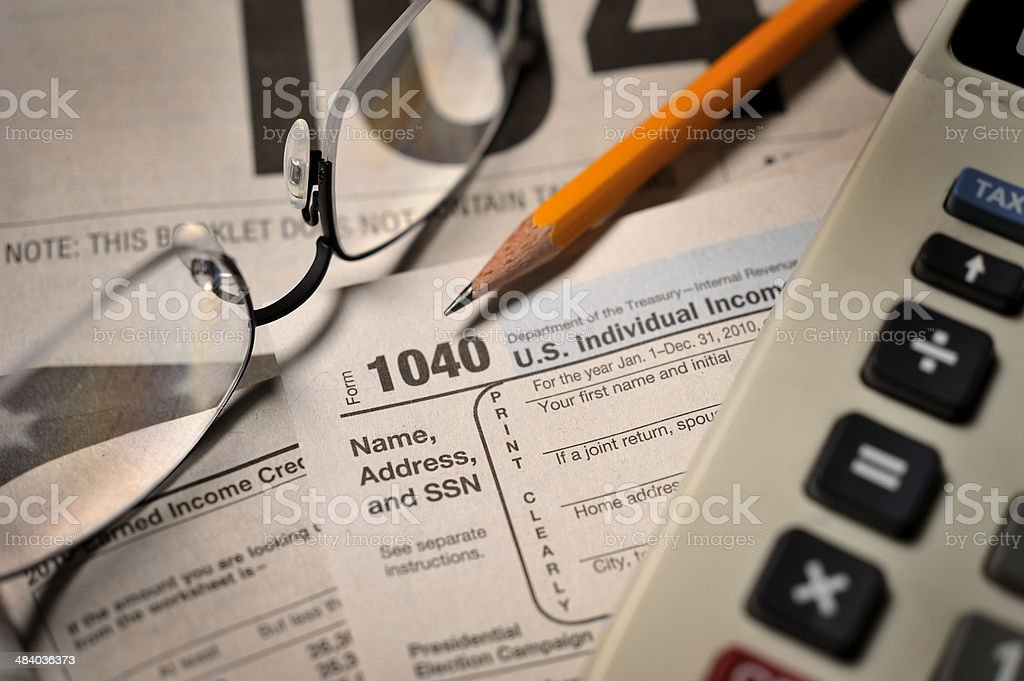 Filing taxes on IRS Form 1040 close-up view stock photo