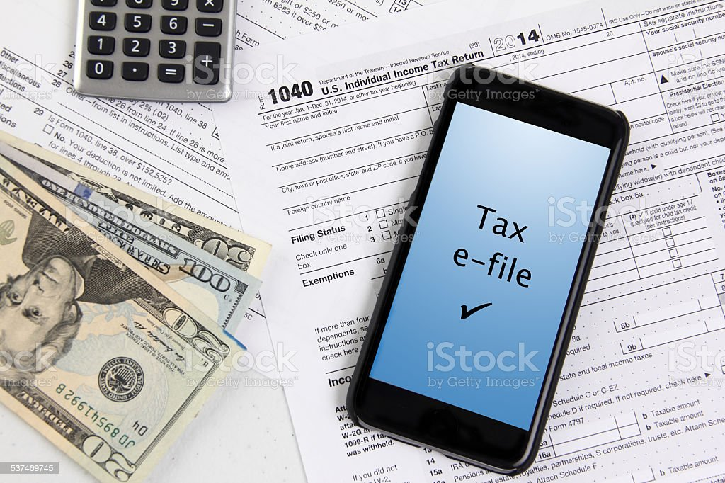 Filing taxes using a mobile phone stock photo