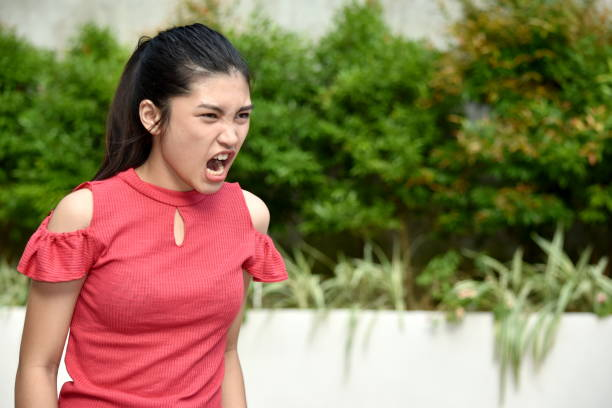 A Filipina Female And Anger A person in an outdoor setting antagonize stock pictures, royalty-free photos & images