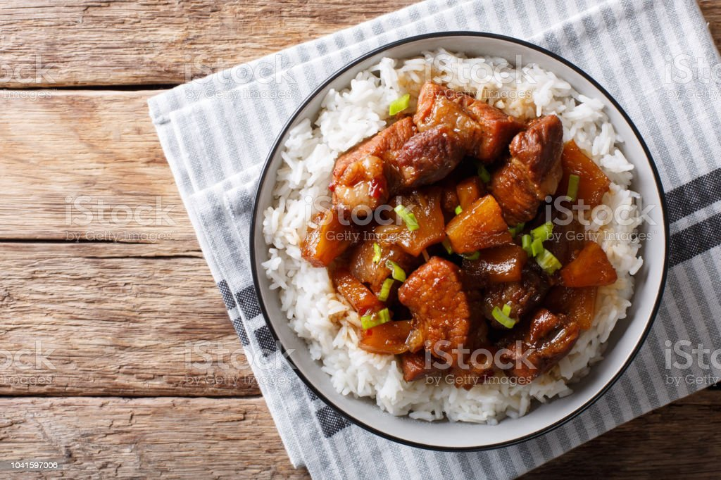 Filipino belly pork hamonado with pineapple and rice close-up. Horizontal top view stock photo
