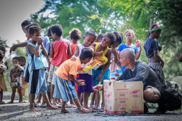 Filipino children standing in a line and holding snack in their hands on Aug 27 2017 in Central Luzon, Philippines1 stock photo