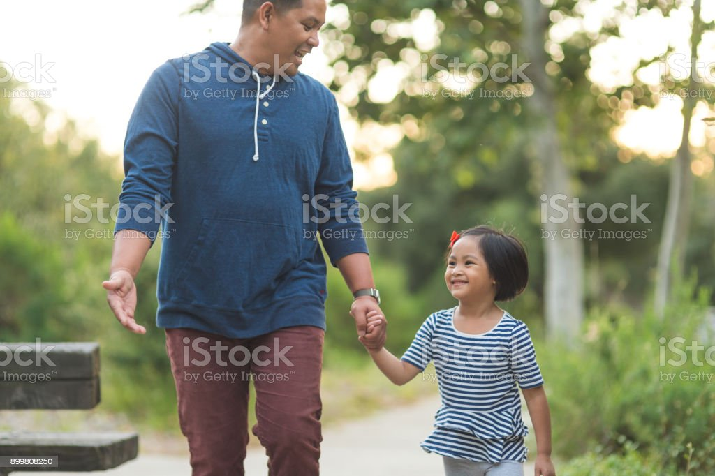 Filipino Dad and Daughter at the Park stock photo