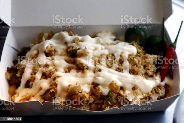 Filipino delicacy called sisig topped with chicharon and mayonnaise picture id1248644694?b=1&k=6&m=1248644694&s=612x612&h=fvlatfjk9zj2j0on3fltg7tmhosxhd 5 x2aplbiiek=