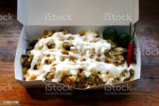 Filipino delicacy called sisig topped with chicharon and mayonnaise picture id1248647739?b=1&k=6&m=1248647739&s=612x612&h=l15rfvrrahtiwkhgbn8r4kabfozauz3psu07dilsh44=