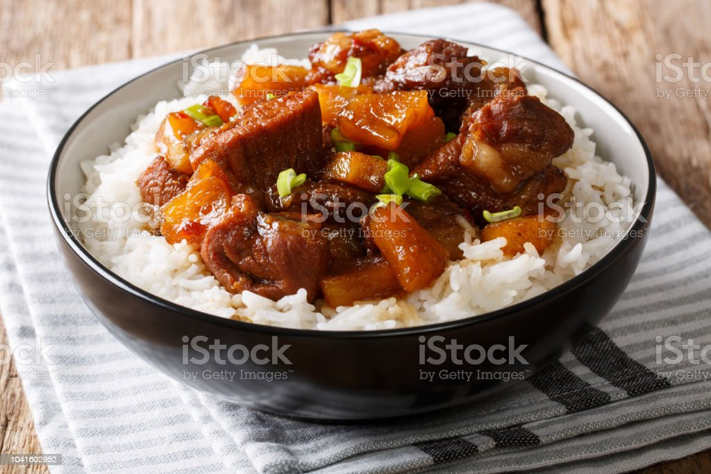 Filipino food: belly pork hamonado with pineapple and rice close-up in a bowl. horizontal stock photo