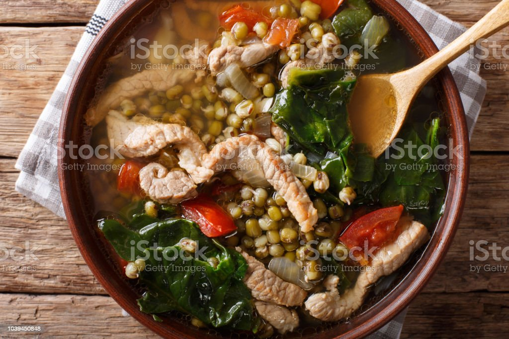 Filipino Mungo Guisado (Mung Bean Soup) close-up in a bowl. horizontal top view stock photo