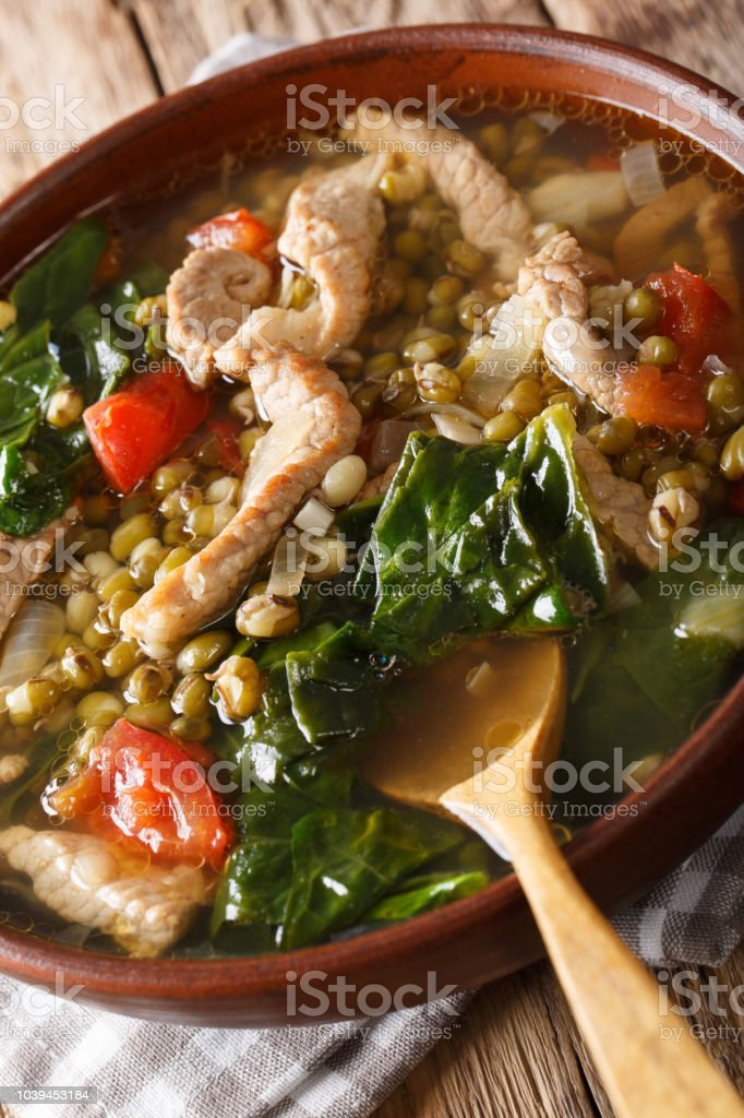 Filipino Mungo Guisado (Mung Bean Soup) close-up in a bowl. vertical stock photo