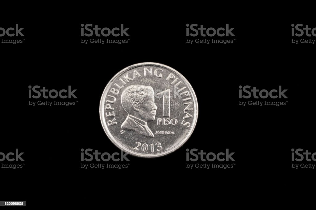 Filipino one piso coin close up on black stock photo