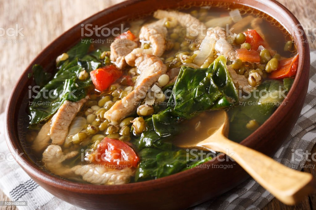 Filipino soup of beans mung with pork closeup in a bowl. horizontal stock photo