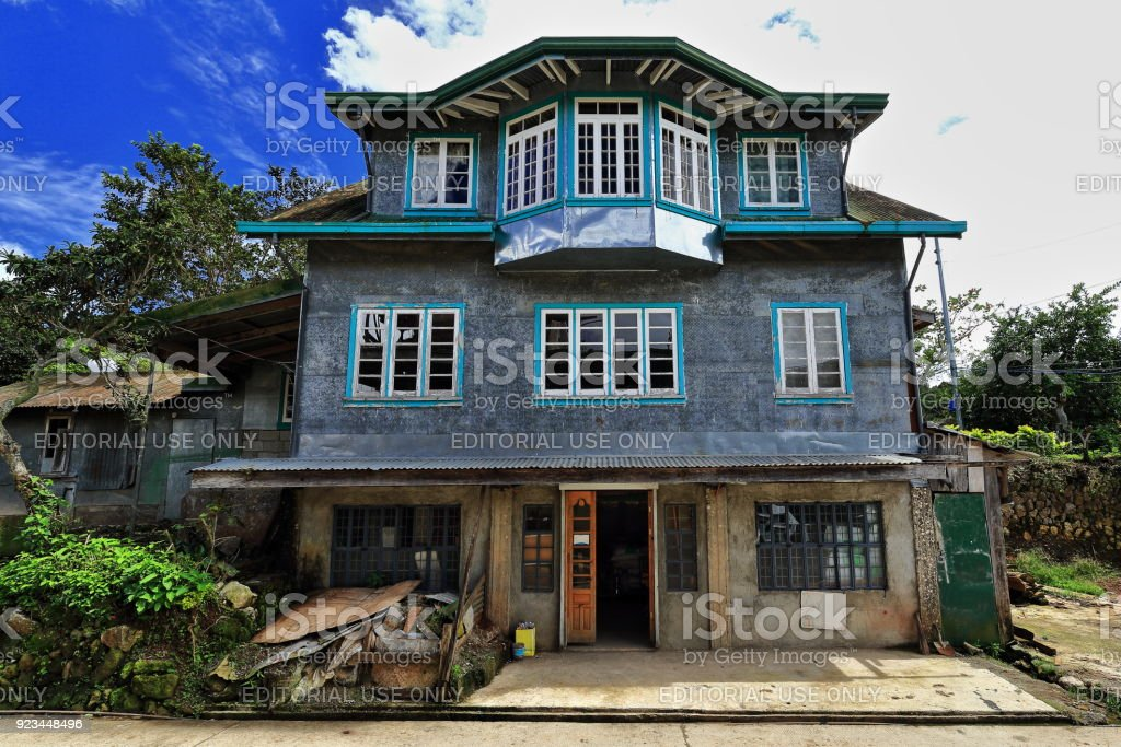 Filipino vernacular architecture-grey house beside the S.Road. Sagada town-Mountain province-Philippines. 0226 stock photo