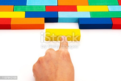 fill in business solutions concept, a piece of wooden block puzzle fit in a blank space