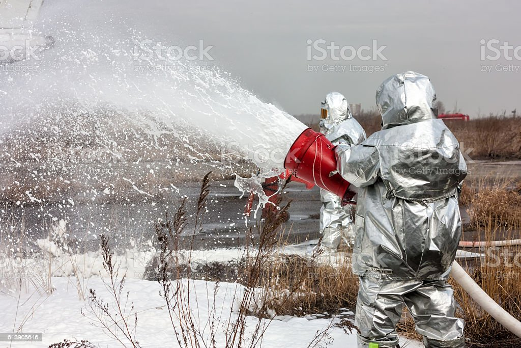 Fill the airplane with fire-fighting foam стоковое фото