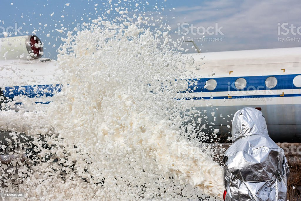 Fill the plane with fire-fighting foam after emergency landing стоковое фото