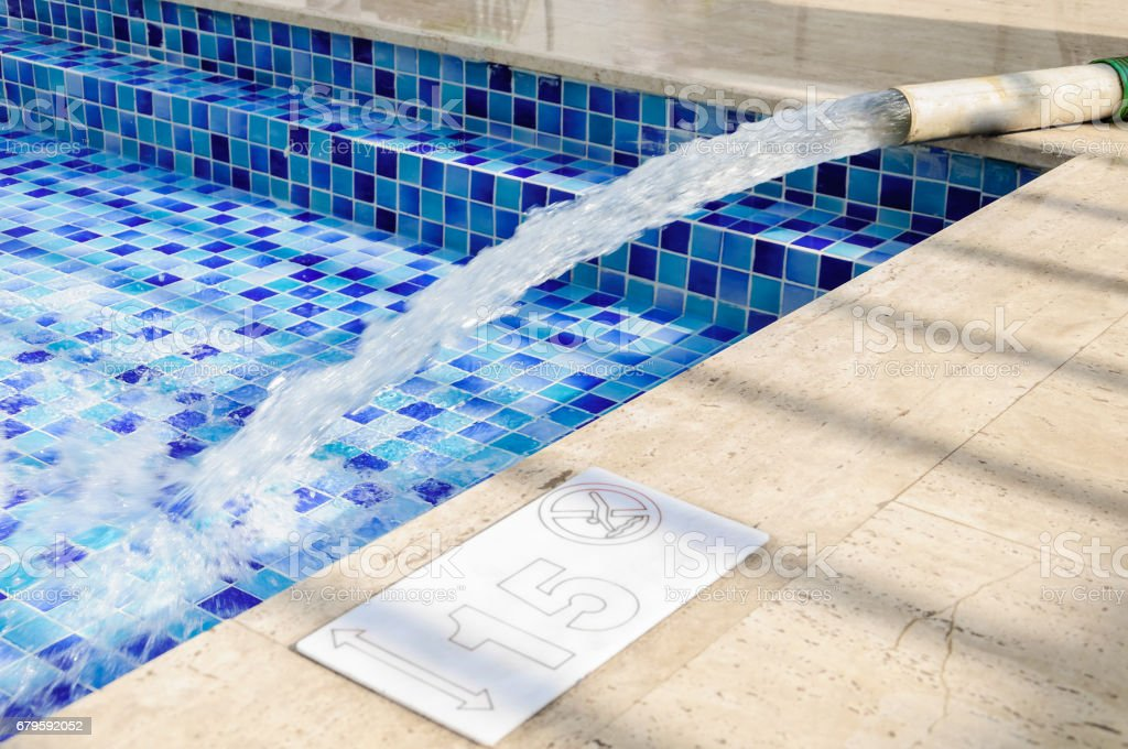 Fill the swimming pool with clean water stock photo