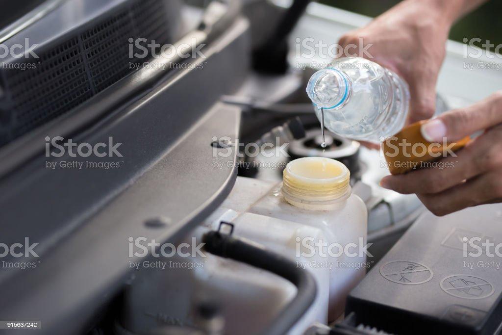 Fill water to radiator stock photo