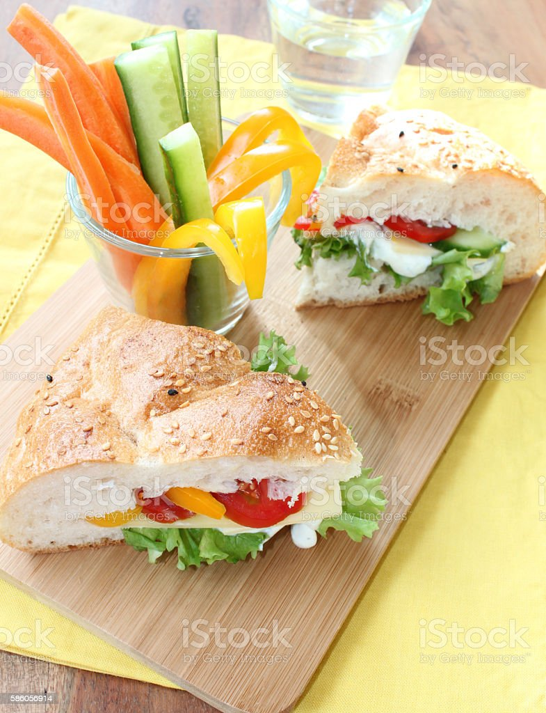 filled flat bread sandwich with vegetable sticks stock photo
