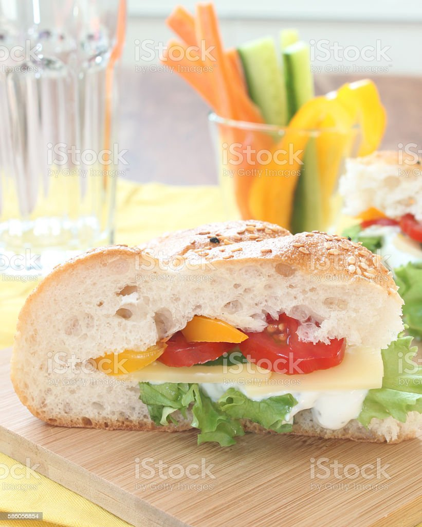 filled flat bread sandwiche with vegetable sticks stock photo