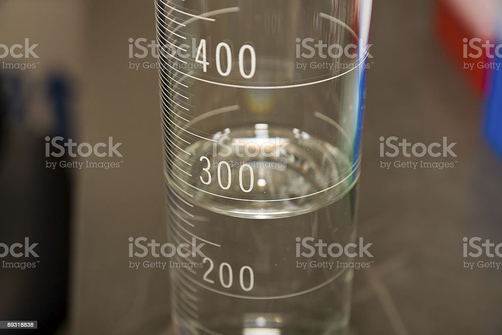 filled glass cylinder stock photo