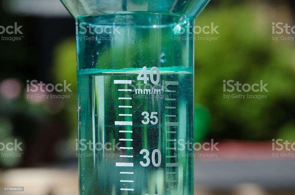 Filled rain gauge stock photo