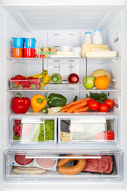 filled refrigerator open refrigeratored filled with food cooler container stock pictures, royalty-free photos & images