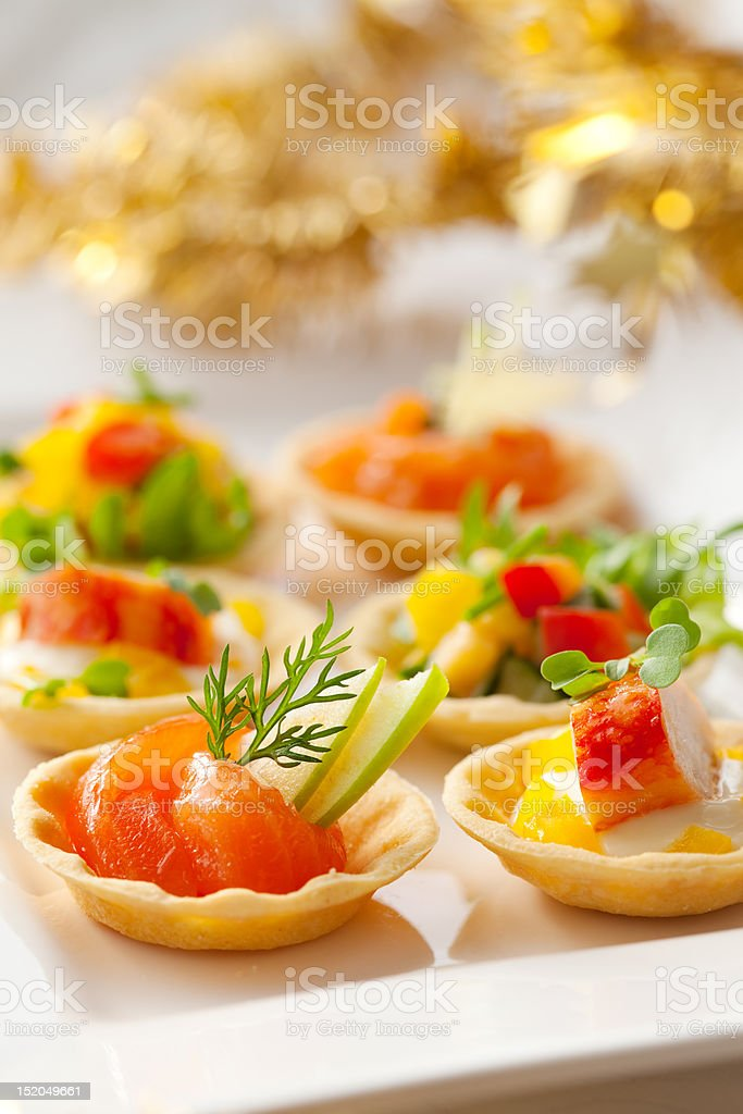 Filled savory tartlet appetizers for the holidays royalty-free stock photo