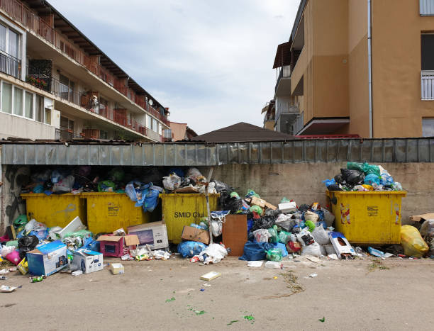 Filled trash bins in populated area in Floresti stock photo