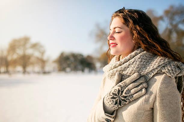filled with the beauty of winter - winterjacke lang damen stock-fotos und bilder