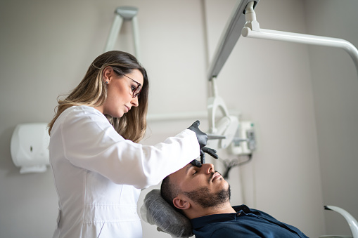 istock Filler injection for male face in beauty clinic 1132333684