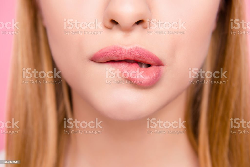 Fillers plump plastic herpes surgery concept. Close up cropped photo of big full natural with lipgloss lips teeth biting lips blonde hair hairstyle isolated on background stock photo